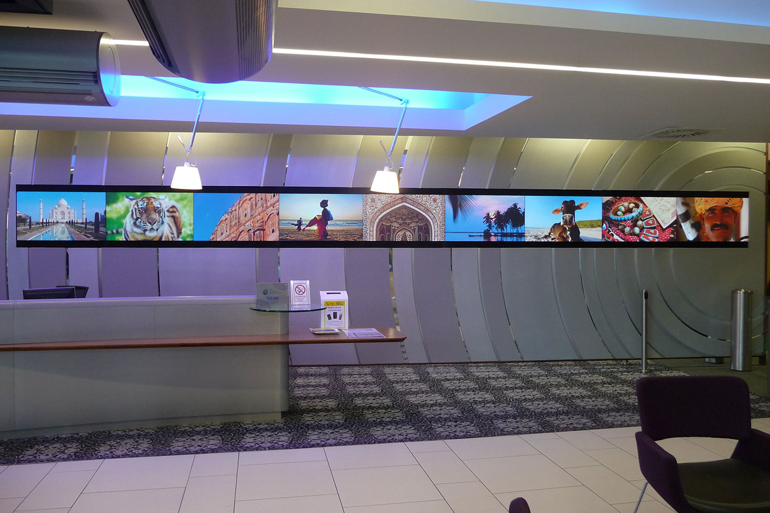 tui reception digital signage face on